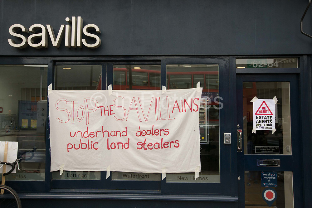 Regeneration protest against Savills estate agents' housing contract with Lambeth Council on 30th July 2016 in London, United Kingdom. Demonstration outside Savills Estate Agents on Battersea Bridge Road to protest against a secured contract to offer Lambeth Council advice on estate regeneration.