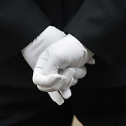 The funeral of former Prime Minister Margaret Thatcher who died Monday April 8. White gloved hands on the back of a police officer.