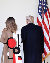 """First lady Melania Trump and President Donald Trump walk back to the Oval Office after pardoning """"Peas"""" from South Dakota at the National Thanksgiving Turkey pardoning ceremony in the Rose Garden of the White House in Washington, DC on November 20, 2018. Photo by Olivier Douliery/ABACAPRESS.COM"""