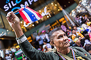 """20 DECEMBER 2013 - BANGKOK, THAILAND:  Anti-government protestors gather in front of Silom Complex, an upscale shopping mall on Silom Rd in Bangkok. Thousands of anti-government protestors, supporters of the so called Peoples Democratic Reform Committee (PRDC), jammed the Silom area, the """"Wall Street"""" of Bangkok, Friday as a part of the ongoing protests against the caretaker government of Yingluck Shinawatra. Yingluck dissolved the Thai Parliament earlier this month and called for national elections on Feb. 2, 2014. The protestors want the elections postponed and the caretaker government to step down. The Thai election commission ruled Friday that the election would go on dispite the protests.         PHOTO BY JACK KURTZ"""