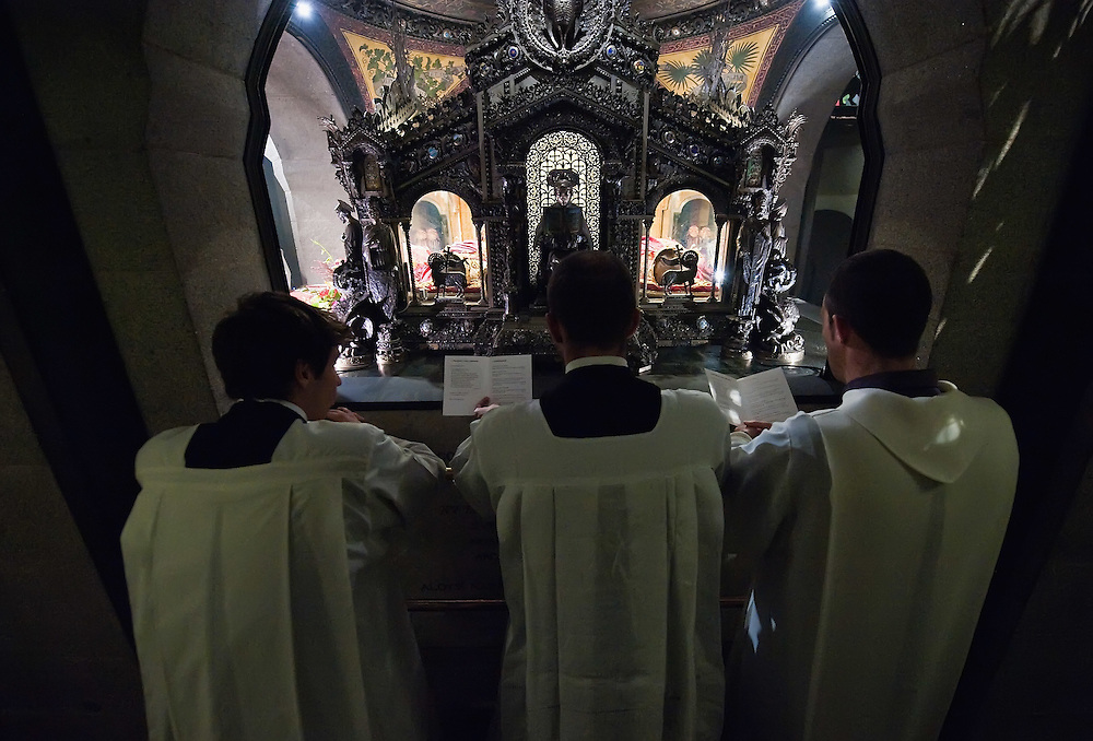 MILAN, ITALY - DECEMBER 07:  Three seminarist pray in front of the relics of Saint Ambrogio on December 7, 2010 in Milan, Italy. The skeleton of Saint Ambrogio lays with the remains of San Gervasio e San Protasio in the ancient basilica of Sant'Ambrogio in the city centre of Milan