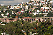 The ancient stone Aqueduct of Queretaro running across the city center of Santiago de Queretaro, Queretaro State, Mexico. The aqueduct was completed in 1735 and is the largest in Mexico.