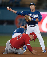 The Dodgers' Chase Utley tries to turn a double play over the Angels' C.J. Cron during the Angels' Freeway Series game against the Dodgers Thursday night at Dodger Stadium.<br /> <br /> ///ADDITIONAL INFO:   <br /> <br /> freeway.0401.kjs  ---  Photo by KEVIN SULLIVAN / Orange County Register  --  3/31/16<br /> <br /> The Los Angeles Angels take on the Los Angeles Dodgers at Dodger Stadium during the Freeway Series Thursday.<br /> <br /> <br />  3/31/16