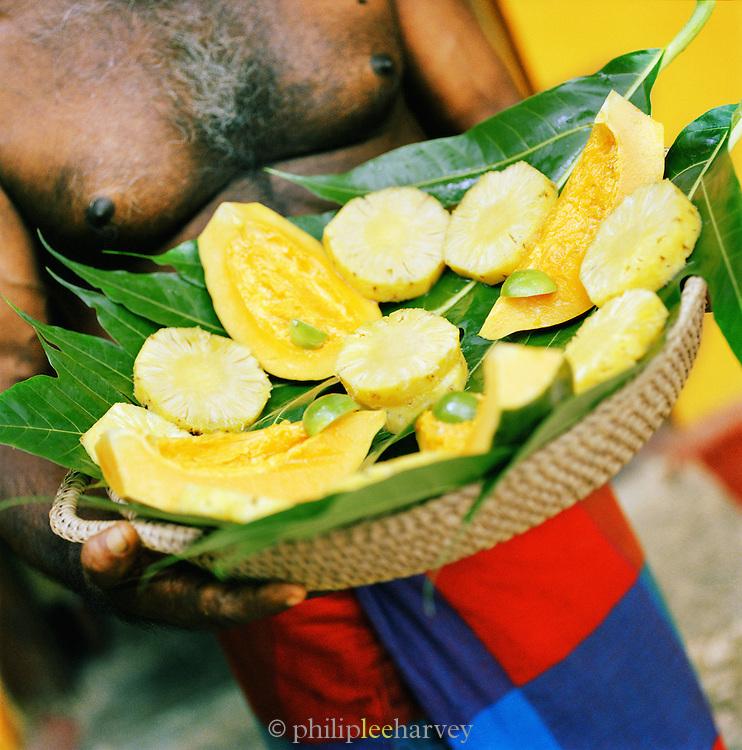 Fresh fruit presented on a basket of leaves in Sri Lanka