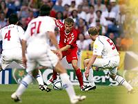 Photo: Scott Heavey, Digitaslport<br /> Euro 2004, Czech Republic v Denmark. Quarter Final stage. Dragao stadium, Porto. 27/06/2004.<br /> The defence of the Czech Republic awaits Jesper Grønkjær, Danmark