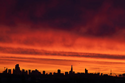 © Licensed to London News Pictures. 24/01/2021. London, UK. The sky is a deep red at Sunrise. The weather forcast is for snow showers in central London later today. Photo credit: Ray Tang/LNP