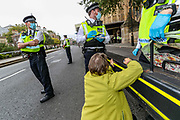 Members of Extinction Rebellion (XR) who glued themselves into the gates outside Houses of Parliament, Westminster Palace by Abingdon Street in London on Wednesday, Sept 9, 2020 - have been arrested ahead of Prime Minister's Questions (PMQs). Extinction Rebellion has organised a week of action to highlight the climate crisis. They say they are holding the government to account for failing to tackle the issue since declaring 2019 a climate emergency. Boris Johnson dismissed the protests at PMQs, branding the group 'a bunch of crusty left-wing anarchists'.<br /> Environmental nonviolent activists group Extinction Rebellion enters its 9th day of continuous ten days protests to disrupt political institutions throughout peaceful actions swarming central London into a standoff, demanding that central government obeys and delivers Climate Emergency bill. (VXP Photo/ Vudi Xhymshiti)