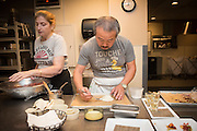 Chefs Hiro Sone, Lissa Doumani prepare puff pastry in the kitchen
