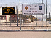 """27 FEBRUARY 2012 - PHOENIX, AZ:    The sign that marks the numbers of inmates who """"served"""" in the Maricopa County Jail system's """"Tent City."""" Maricopa County Sheriff Sheriff Joe Arpaio opened """"Tent City"""" with surplus US Army tents from the Korean War in 1993. The tents, which are not air conditioned, house about 2,000 county inmates at any given time. Monday's announcement is the kickoff event of the Sheriff's celebration of 19 years of Tent City. The sign Arpaio  announced Monday is based on the sign a popular fast food chain used to use to mark the number of hamburgers served. PHOTO BY JACK KURTZ"""