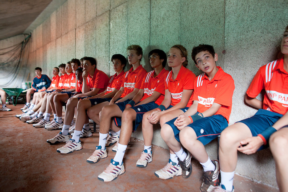 Roland Garros. Paris, France. June 1st 2012.A day with the ball boys..Team briefing with coaches under the Suzanne Lenglen Court.