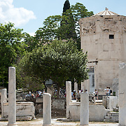 The Horologion of Andronikos of Kyrrhos (also known as the Tower of the Winds) is a work by architect and astonomer Andronikos of Kyrrhos in Macedonia. It is located on the northern slop of the Acropolis near the Roman Agora (and is now within the Ancient Agora archeological compound). It was built during the late Hellenistc period, possibly at the end of the 2nd century BC. Built between 19 BC and 11 BC, the Roman Agora was the commercial center of ancient Athens. It featured a large rectangular building with an open courtyard surrounded by shops, storerooms, and offices.