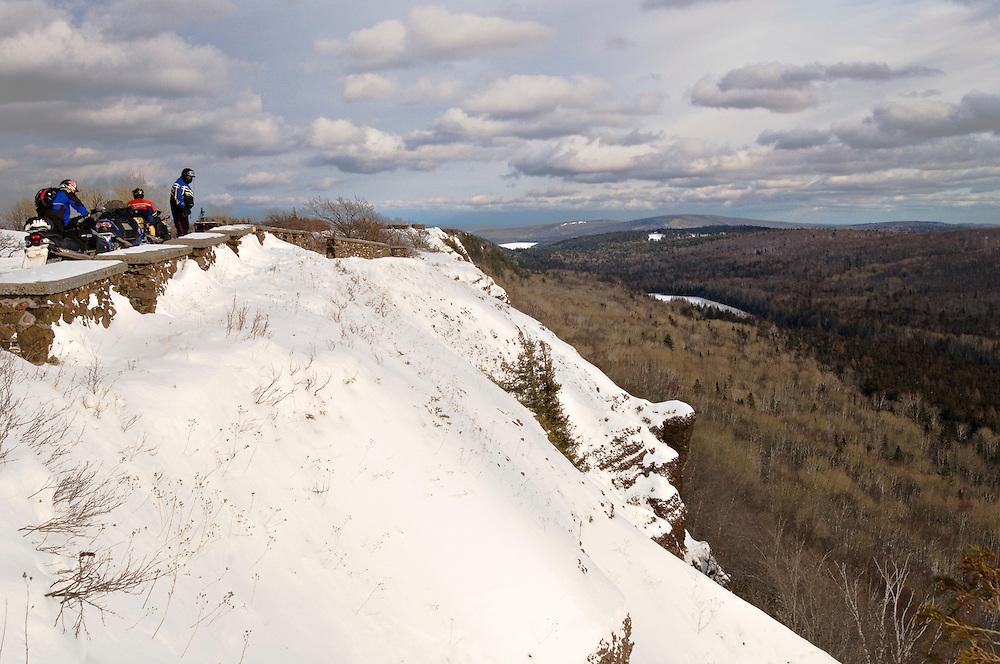 Snowmobilers atop Brockway Mountain near Copper Harbor on the Keweenaw Peninsula of Michgan's Upper Peninsula.