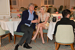 The MARQUESS OF WORCESTER and the HON.SOPHIA HESKETH at the launch of Mrs Alice in Her Palace - a fashion retail website, held at Fortnum & Mason, Piccadilly, London on 27th March 2014.