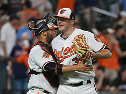 June 20, 2017 - Baltimore, MD, USA - Baltimore Orioles closer Brad Brach, right, celebrates with catcher Welington Castilo after his 13th save of the season in a 6-5 win against the Cleveland Indians at Oriole Park at Camden Yards in Baltimore on Tuesday, June 20, 2017. (Credit Image: © Kenneth K. Lam/TNS via ZUMA Wire)