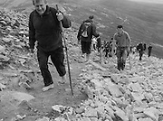 Many climbers participating in the pilgrimage do so as an act of penance, some in their bare feet.