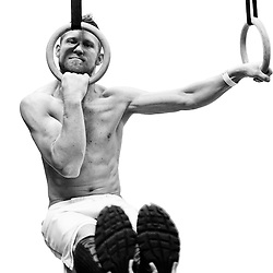 Josh Corley in an L-sit using the rings