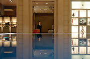 Moscow, Russia, 04/01/2004..Security guard at the luxurious but largely deserted Crocus City shopping mall.