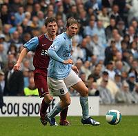 Photo: Paul Greenwood.<br />Manchester City v Aston Villa. The FA Barclays Premiership. 16/09/2007.<br />Man City's Michael Johnson, (R) betas Stilian Petrov to the ball