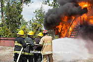 63818-02511 Firefighters at oilfield tank training, Marion Co., IL
