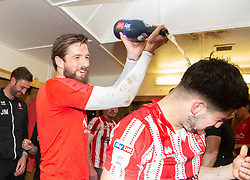 Josh Vickers of Lincoln City pours champagne over Tom Pett of Lincoln City  - Mandatory by-line: Alex James/JMP - 22/04/2019 - FOOTBALL - Sincil Bank Stadium - Lincoln, England - Lincoln City v Tranmere Rovers - Sky Bet League Two