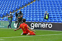Football - 2020 / 2021 UEFA Nations League - Group B4 - Wales vs Bulgaria<br />      <br /> Neco Williams of Wales celebrates scoring his team's winning goal  during extra time in front of  a TV crew & a lone steward wearing a mask & high vis jacket in an otherwise  empty stand					<br /> in a match played with no crowd due to Covid 19 coronavirus emergency regulations, in an almost empty ground, at the Cardiff City Stadium.<br /> <br /> COLORSPORT/WINSTON BYNORTH