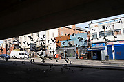 Local atmosphere due to Coronavirus lockdown is felt on a street by street level as streets remain deserted as a flock of feral pigeons take flight outside the derelict New Palladium Cinema, once the Hockley Picture House under Hockley Flyover in Hockley as people observe the stay at home advice from the government on 7th April 2020 in Birmingham, England, United Kingdom. Coronavirus or Covid-19 is a new respiratory illness that has not previously been seen in humans. While much or Europe has been placed into lockdown, the UK government has announced more stringent rules as part of their long term strategy, and in particular social distancing.