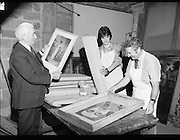 National Gallery preparing Paintings for Shipment to US 28/09/1976.09/28/1976.28th September 1976.Picture of National Gallery Staff preparing paintings for shipment. Gallery director Mr. James White (left) is pictured inspecting the paintings.