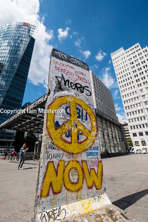 Section of former Berlin wall with graffiti at Potsdamer Platz in Berlin Germany