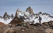 """Mount Fitz Roy. The trail called Sendero Fitz Roy leads to Laguna de Los Tres (20 km round trip with 1100 meters gain), in Los Glaciares National Park. To reveal the best view, slightly descend left of the Laguna then ascend 50 m to a bare knoll overlooking both Lago Sucia and Laguna de Los Tres under mighty Mount Fitz Roy (3405 m or 11,171 ft elevation). El Chalten mountain resort is in Santa Cruz Province, Argentina, Patagonia, South America. Monte Fitz Roy is also known as Cerro Chaltén, Cerro Fitz Roy, or Mount Fitz Roy. The first Europeans recorded as seeing Cerro Fitz Roy were the Spanish explorer Antonio de Viedma and his companions, who in 1783 reached the shores of Viedma Lake. In 1877, Argentine explorer Francisco Moreno saw the mountain and named it Fitz Roy in honour of Robert FitzRoy who, as captain of HMS Beagle, had travelled up the Santa Cruz River in 1834 and charted large parts of the Patagonian coast. Mt Fitz Roy was first climbed in 1952. Cerro is a Spanish word meaning hill, while Chaltén comes from a Tehuelche word meaning """"smoking mountain"""", due to clouds that usually form around the peak.  Los Glaciares National Park and Reserve are honored on UNESCO's World Heritage List."""