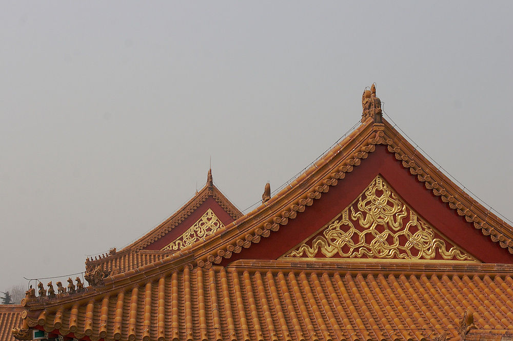 Roof details at The Forbidden City in Beijing, China. Gu Gong, called The Forbidden City in English, is located in the center of Beijing.  It was once the imperial palace for the Ming and Qing Dynasties and is just shy of 183 acres.