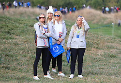 Erica Stoll (left), Grace Barber (centre left) and Katie Poulter (centre right) watch the action during the Fourballs match on day one of the Ryder Cup at Le Golf National, Saint-Quentin-en-Yvelines, Paris.