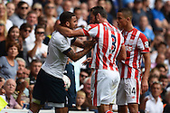 Erik Pieters of Stoke City tussles with Kyle Walker of Tottenham Hotspur after he fouls the Spurs defender. Barclays Premier league match, Tottenham Hotspur v Stoke city at White Hart Lane in London on Saturday 15th August 2015.<br /> pic by John Patrick Fletcher, Andrew Orchard sports photography.