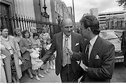 Mass For The 26th Dail.     (T3)..1989..29.06.1989..06.29.1989..29th June 1989..After the General Election  a mass took place today at the Pro-Cathedral in Dublin. The mass was to bless   the incoming TD's who were successful in their election to the Dáil...Gerry Collins TD speaks to the media on his arrival at the Pro-Cathedral.