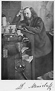 Dmitiri Ivanovich Mendeleyev (1834-1907), Russian chemist. Working at his desk.