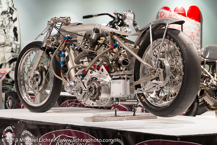"""John Stein's Barnjob drag bike originally built and campaigned by Clem Johnson, here displayed in the """"Built for Speed"""" exhibition curated by Michael Lichter and Paul D'Orleans in the Russ Brown Events Center as part of the annual """"Motorcycles as Art"""" series at the Sturgis Buffalo Chip during the Black Hills Motorcycle Rally. SD, USA. August 7, 2014.  Photography ©2014 Michael Lichter."""