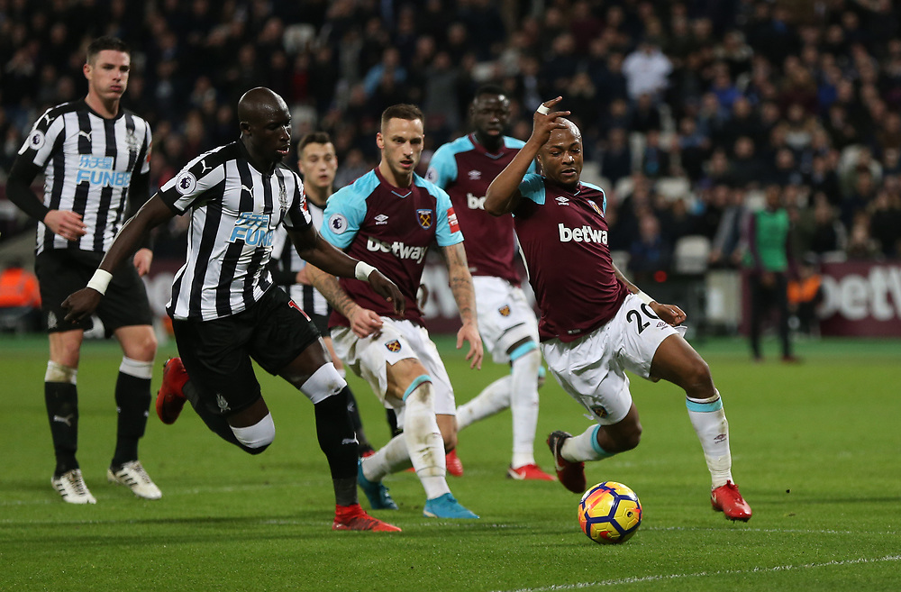 West Ham United's Andre Ayew and Newcastle United's Mohamed Diame<br /> <br /> Photographer Rob Newell/CameraSport<br /> <br /> The Premier League - West Ham United v Newcastle United - Saturday 23rd December 2017 - London Stadium - London<br /> <br /> World Copyright © 2017 CameraSport. All rights reserved. 43 Linden Ave. Countesthorpe. Leicester. England. LE8 5PG - Tel: +44 (0) 116 277 4147 - admin@camerasport.com - www.camerasport.com