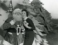 1957 Linda Crystal with Santa during the Christmas Santa Claus Lane Parade on Hollywood Blvd.