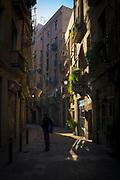 A man stands on Carrer dels Assaonadors, Barcelona