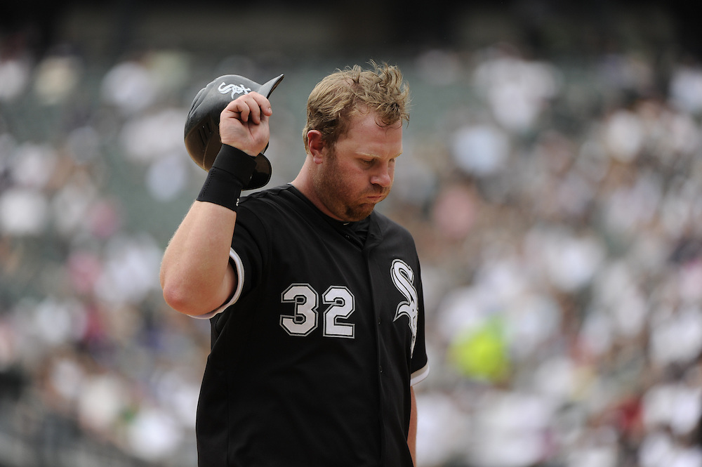 CHICAGO - MAY 22:  Adam Dunn #32 of the Chicago White Sox reacts after striking out against the Los Angeles Dodgers on May 22, 2011 at U.S. Cellular Field in Chicago, Illinois.  The White Sox defeated the Dodgers 8-3.  (Photo by Ron Vesely)  Subject:   Adam Dunn