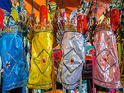 16 JANUARY 2015 - BANGKOK, THAILAND:  Opera costumes from the Sai Yong Hong Opera Troupe hanging at the Chaomae Thapthim Shrine, a Chinese shrine in a working class neighborhood of Bangkok near the Chulalongkorn University campus. The troupe's nine night performance at the shrine is an annual tradition and is the start of the Lunar New Year celebrations in the neighborhood. Lunar New Year, also called Chinese New Year, is officially February 19 this year. Teochew opera is a form of Chinese opera that is popular in Thailand and Malaysia.   PHOTO BY JACK KURTZ