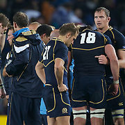 The dejected Scottish team after their loss to England during the England V Scotland Pool B match during the IRB Rugby World Cup tournament. Eden Park, Auckland, New Zealand, 1st October 2011. Photo Tim Clayton...