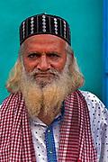 Portrait of a moslem man outside mosque, Mysore/Mysuru, Karnataka