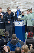 Putney, London, Sjoerd HAMBURGER, President OUBC, and Deaglan MCEACHERN, President CUBC, watch the Gold Sovereign fall, after The Toss, on the podium, at Putney Hard, 156th University Boat Race, River Thames, between Putney and Chiswick, on the Championship Course.  Saturday  03/04/2010 [Mandatory Credit Karon Phillips/Intersport Images]