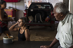 October 9, 2016 - Boa Viagem, Brazil - Occasionally Mr. José Receives a visit from his family, but he said it is very rare que this to happen. In this photo Rosalia Maria, wife of Mr. José, having lunch.  José Belmiro dos Santos is 84 years old, married to Rosalia Maria da Conceição and has nine children. He is retired since 1997 and works in a parking taking care of vehicles. The parking lot is situated in an abandoned building in Boa Viagem, in Recife, Pernambuco state, Brazil.Mr. José has to live in the building and can only visit family once a month. He thinks it's dangerous, because the parking lot is located inside a slum, but need to earn cash and stay home another person can take his job.Mr. José is part of a national statistic that indicates an increase in the number of pensioners who return to work in Brazil, 5.9% in the first quarter of 2012 to 6.5% in the second quarter 2016 (data from the Brazilian Institute of geography and Statistics), due to the current economic crisis.The government of the current President Michel Temer has as one of the goals the approval of Welfare Reform, thus ensuring clearer rules for retirement and the increase in the contribution to the public coffers. The approval of new rules for retirement might take the Brazil of the crisis and increase a government approval rating scored by polemics and an impeachment questioned by the opposition. (Credit Image: © Diego Herculano/NurPhoto via ZUMA Press)