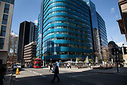 Modern glass offices at Aldgate in the City of London, England, United Kingdom. As Londons financial district grows in height, the architecture has changed the face of Londons financial district, with many different companies occupying the various floors and levels.