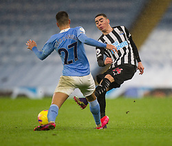 Joao Cancelo of Manchester City (L) and Miguel Almiron of Newcastle United in action - Mandatory by-line: Jack Phillips/JMP - 26/12/2020 - FOOTBALL - Etihad Stadium - Manchester, England - Manchester City v Newcastle United - English Premier League