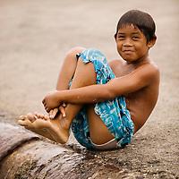 Fare, Huahine, French Polynesia, boys playing at pier