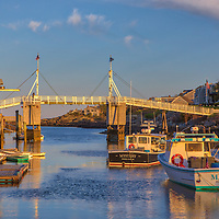 Sunset harbor scenery of the iconic and historic Perkins Cove Drawbridge in Ogunquit, Maine, starting point for the beautiful and picturesque Marginal Way.<br /> <br /> Maine Perkins Cove photography photos are available as museum quality photography prints, canvas prints, acrylic prints, wood prints or metal prints. Prints may be framed and matted to the individual liking and decorating needs.<br /> <br /> Good light and happy photo making!<br /> <br /> My best,<br /> <br /> Juergen