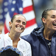 Flavia Pennetta, (right), Italy, with Roberta Vinci Italy, joke at the trophy presentation after the Women's Singles Final match during the US Open Tennis Tournament, Flushing, New York, USA. 12th September 2015. Photo Tim Clayton