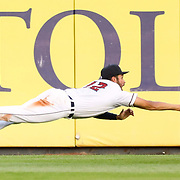 Toledo's Riley Greene dives and misses a ball in the outfield during a Triple-A East baseball game between the Toledo Mud Hens and the Indianapolis Indians at Fifth Third Field in Toledo on Thursday, Aug. 19, 2021. THE BLADE/KURT STEISS